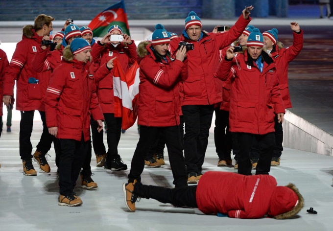 Austrian hockey coach Alpo Suhonen, who once threatened to sue Don Cherry for pointing out he shared his name with a dog food brand, fell while trying to take pictures. Other Austrians couldn't be bothered to help. The spirit of unity.